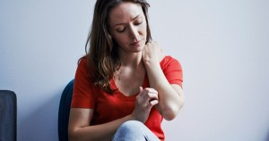 Woman-scratching-her-arm